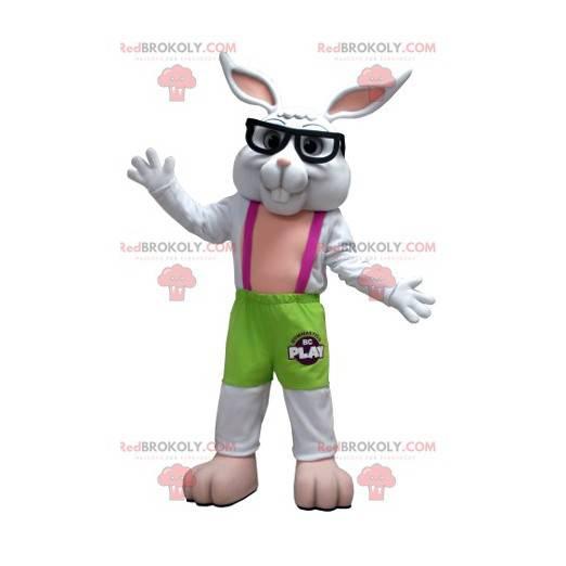 Grünes und rosa weißes Kaninchenmaskottchen mit Brille -