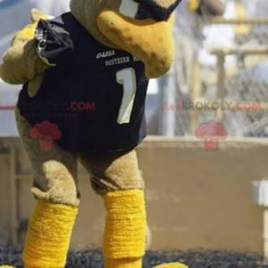 Maskot velký béžový a žlutý pták ve sportovním oblečení -