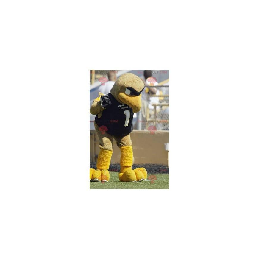 Maskotka duży beżowy i żółty ptak w odzieży sportowej -