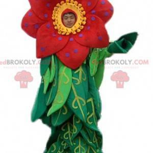 Schönes rotes und gelbes Blumenmaskottchen mit Blättern -