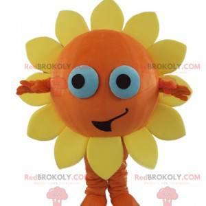 Oransje og gul blomstemaskot veldig smilende sol -