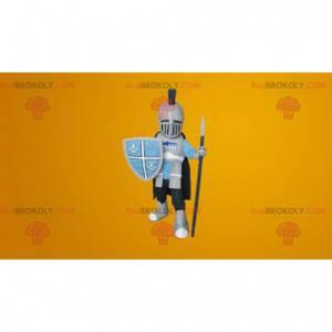 Mascota caballero protegida con casco y armadura. -