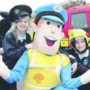 Police officer mascot in blue and yellow uniform -