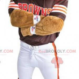 Hundemaskottchen als amerikanischer Fußballspieler verkleidet -