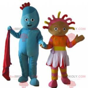 2 maskotki, jedna niebieskiego bałwana, druga kolorowa