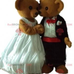 2 maskoti plyšového medvídka oblečeni do svatebního oblečení -