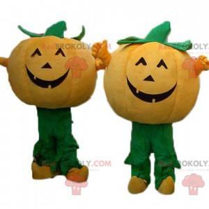 2 oranje en groene pompoenmascottes voor Halloween -