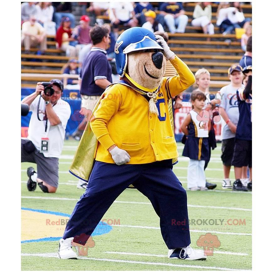 Medvěd hnědý maskot v žluté a modré oblečení - Redbrokoly.com