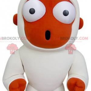 Pomarańczowo-biała małpa maskotka wygląda na zaskoczonego -