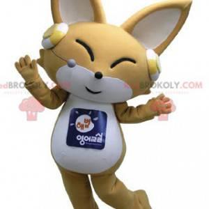 Maskottchen beige und weißer Fuchs mit Kopfhörern an den Ohren