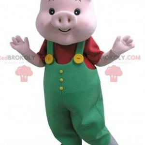 Pink pig mascot with green overalls - Redbrokoly.com