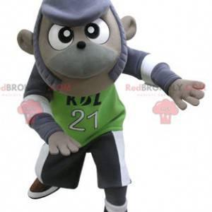 Lila und graues Affenmaskottchen in Sportbekleidung -