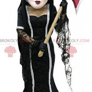 Brown witch mascot in dress with an ax - Redbrokoly.com