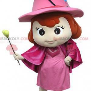 Rosa Feenmaskottchen mit einem Hut und einem Zauberstab -