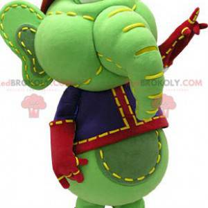 Green and yellow elephant mascot in blue and red outfit -