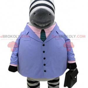 Zebra mascotte gekleed in een blauw pak met stropdas -