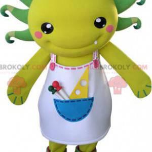 Gul og grønn skapningsmaskot med forkle - Redbrokoly.com