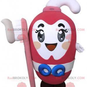 Rosa tannkrem maskot holder en tannbørste - Redbrokoly.com