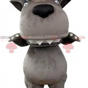 Graues Wolfsmaskottchen mit einem Schaf auf dem Kopf -
