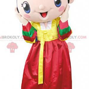 Maskot bruneta žena nosí žluté a červené šaty - Redbrokoly.com