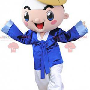 Smiling boy mascot dressed in traditional attire -