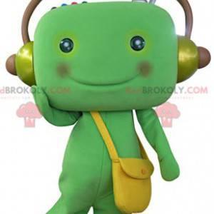 Green snowman mascot with headphones - Redbrokoly.com