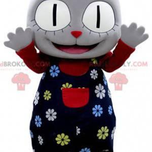 Graues Katzenmaskottchen mit einem Blumenoutfit - Redbrokoly.com