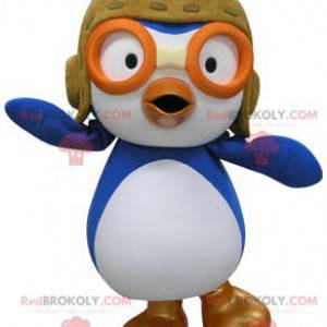 Blue and white bird mascot in airplane pilot outfit -