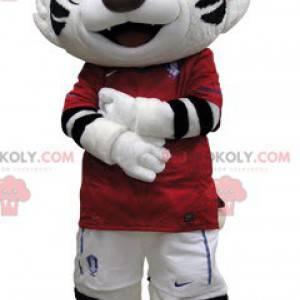 Maskot černý a bílý tygr oblečený v červené barvě -