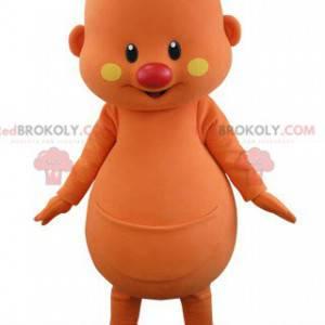 Orange snowman mascot with a flower on his head - Redbrokoly.com