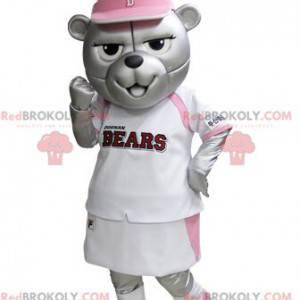 Graues Bärenmaskottchen im rosa und weißen Tennisoutfit -
