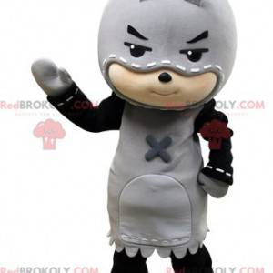 Child mascot disguised as an executioner. Childish mascot -