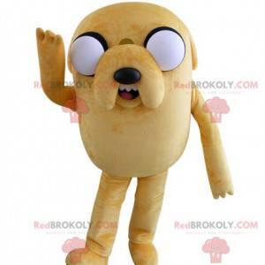 Duży żółty pies maskotka wyglądający paskudnie z dużymi oczami