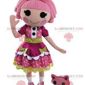 Dukke maskot kledd i en vakker rosa og grønn kjole -