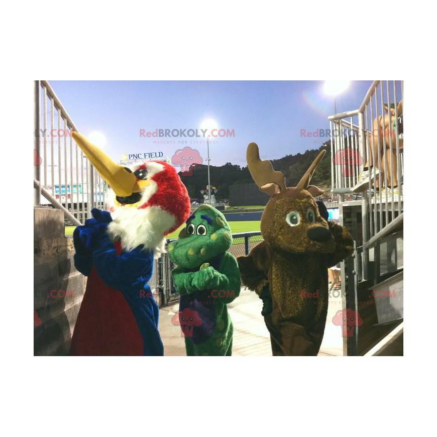 3 Maskottchen ein Vogel, ein braunes Rentier und ein grüner