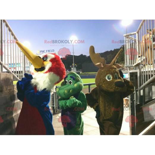 3 mascots a bird, a brown reindeer and a green dragon -