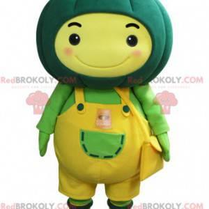 Żółty bałwan maskotka z zieloną dynią na głowie - Redbrokoly.com