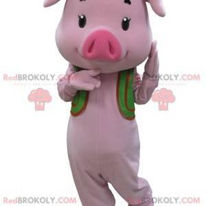 Różowa maskotka świnia z zieloną kamizelką - Redbrokoly.com