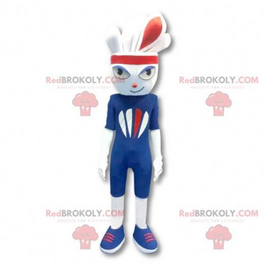 Bílý sportovní králík maskot oblečený v modré barvě -