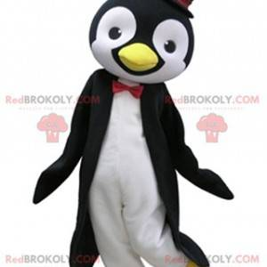 Svart og hvit pingvin maskot med topp lue - Redbrokoly.com