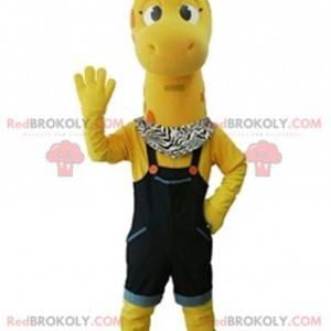 Maskot žlutá žirafa s modrým overalem - Redbrokoly.com