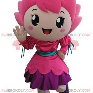 Smilende liten jente rosa blomst maskot - Redbrokoly.com