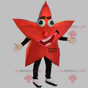 Riesiges Maskottchen mit roten und schwarzen Sternen -