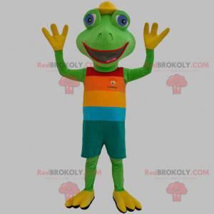 Grønn froskmaskot kledd i et fargerikt antrekk - Redbrokoly.com