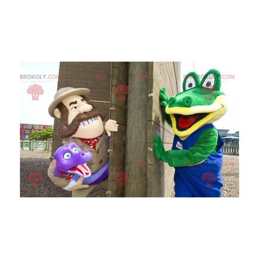 2 mascots a green crocodile and an explorer holding a snake -