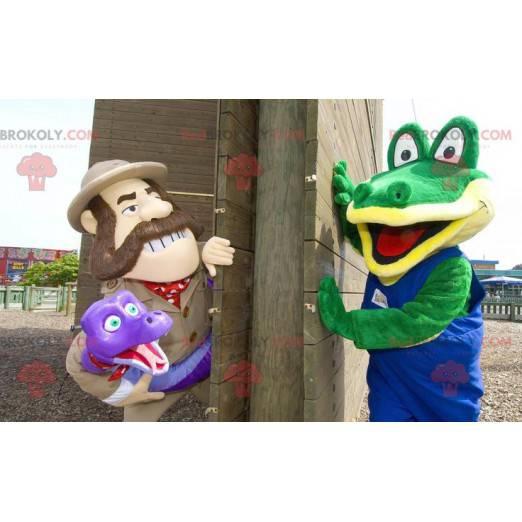 2 maskoti, zelený krokodýl a průzkumník, který drží hada -