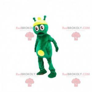 Grünes und gelbes außerirdisches außerirdisches Maskottchen -