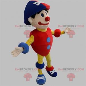 Kleurrijke rood blauw en geel sneeuwpop clown mascotte -