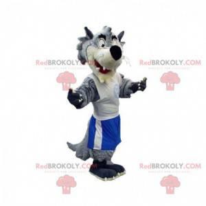 Szaro-biała maskotka wilk ubrany w odzież sportową -