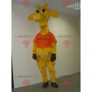 Mascote girafa amarela e laranja com olhos azuis -